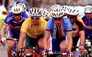 Daniel Polson cycling with other Paralympians