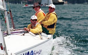 Image of 3 Australian Paralympic Team sailors in a boat on the water