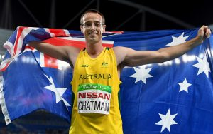 Australian Paralympian Aaron Chatman holding an Australian flag around his shoulders