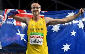 Australian Paralympian Aaron Chatman holding an Australian flag around his shoulders