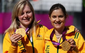 Paralympians Stephanie Morton and Felicity Johnson holding gold medals