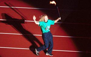 Australian Paralympian Katrina Webb carrying the Sydney 2000 Paralympic Flame