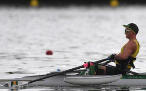 Australian Paralympian Erik Horrie rowing on the water
